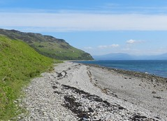 Eyre Point Coastline, Island of Raasay, June 2012 (allanmaciver) Tags: blue sky green grass clouds point island freedom bay haze warm day cloudy stones remote lonely breeze streaks eyre raasay allanmaciver