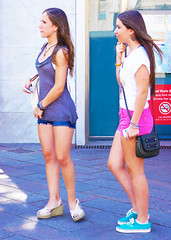 Having just met (chrisk8800) Tags: barcelona street city girls portrait people urban face lumix nice eyes women pretty legs candid models young streetphotography streetlife panasonic attractive teenager shorts females appealing street photography hair dark