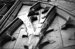 Cathedral window, Coventry (Joybot) Tags: coventry cathedral church westmidlands stmichael saintmichael england britain uk unitedkingdom arch arches window archway filledin filled bricked brickedup ruins ruined old former 35mm film black white fujica stx1n jessopspan400 bwfp gothic stone pan400 jessops            50mm