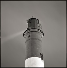 lighthouse (_Alexei) Tags: camera old light bw lighthouse white black 120 6x6 film blanco night analog vintage square still tallinn estonia ray y kodak negro d76 hasselblad negative scanned ambient sw medium format mf 100 but manual simple schwartz weiss developed f4 yf eesti kopli 500cm sonnar tmx  150mm 100tmx functioning lasnamae tuletorn autaut   5agit30sec