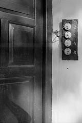 (arkkasal) Tags: street door shadow 2 house 3 film argentina analog 35mm 50mm 1 casa calle puerta cabo bell iso400 5 4 cable olympus om10 button hp5 rua timbre ilford zuiko 400asa baires 12345 buenosaries boton analogico