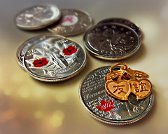 There's no price for friendship. (Through Serena's Lens) Tags: life canada closeup gold still bokeh coins character chinese collection cents 25 currency pendant denomination