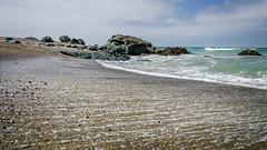 Howell's Point/Taramea (Kathrin & Stefan) Tags: ocean newzealand sky cloud beach nature rock bay outdoor wave line pebble foam southisland tasmansea riverton foveauxstrait oraka colacbay raka