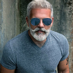 1163 (rrttrrtt555) Tags: hairy muscles sunglasses shirt tattoo hair beard glasses masculine gray curls attitude handlebar shoulders mustache