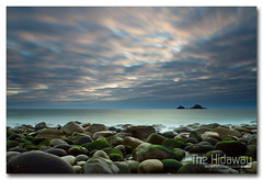 Porth Naven (Simon Bone Photography) Tags: longexposure sea sky cloud sun reflection beach silhouette cornwall smooth boulders cotvalley cornishcoast thebrisons canon1740mmlf4 cornishsunsets wwwthehidawaycouk canoneos7d hoyandx400 9stopfilter porthnaven hitechnd09reversegrad
