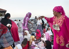Woman Giving Food During Maulidi Festival, Lamu, Kenya (Eric Lafforgue) Tags: africa color childhood horizontal island photography kid sitting child kenya culture unescoworldheritagesite afrika tradition lamu youngadult swahili afrique eastafrica smallgroupofpeople qunia lamuisland lafforgue traveldestination africanethnicity childrenchild kenyaafrica muslimislam  qunia  youngwomenwoman   119179 kea exterioroutdoors   tradingroute blackethnicity a midadultmidadults