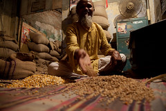 Middleman selling grain and seed in Bangladesh (CIMMYT) Tags: man shop proud person persona vendedor office store corn asia forsale market sale wheat grain seed oficina mercado tienda vendor showing selling atwork supplychain maize bangladesh hombre venta trigo grano southasia southasian bangladeshi valuechain middleman mostrando maz semilla enventa orgulloso alaventa vendiendo cimmyt eneltrabajo intermediario cadenadevalor asiadelsur banglades cadenadesuministro