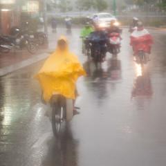 ho chi minh city-5343 (yukkycakes) Tags: blue red green wet yellow dangerous vietnam rainy scooters rushhour raining motorbikes poncho hochiminhcity slippery southvietnam formerlysaigon