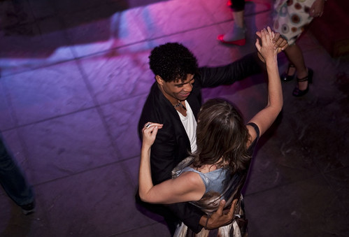 Carlos Acosta dancing with screenwriter Eirene Houston at the Day of the Flowers afterparty at The Caves