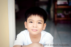 ... (Gilbert Rondilla) Tags: boy portrait people cute male boys childhood smiling kids children lens asian outdoors 50mm nikon day sitting child philippines young smiles manila innocence filipino nikkor frontdoor pinoy oneperson frontview whiteshirt headandshoulders brownhair 18d nikkorlens casualclothing 79years d90 lookingatcamera 50mm18d childrenonly oneboyonly 67years asianethnicity nikond90 valenzuelacity eastasianethnicity humanbodypart gilbertrondilla gilbertrondillaphotography luisianian gettyimagesphilippines frontdoorphotography