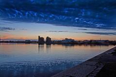 East Float towards Wallasey (Tony Shertila) Tags: sunset red england sky reflection water weather night clouds docks dock europe cloudy britain birkenhead mersey wallasey wirral merseyside eastfloat greatfloat mygearandme