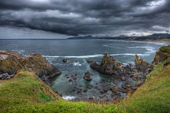 Yaqina Head, Newport, Oregon (Thad Roan - Bridgepix) Tags: ocean sky lighthouse beach nature water grass rain clouds oregon landscape rocks pacific head cove newport pacificnorthwest wildflowers hdr facebook d800 yaquina 201205