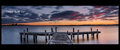 Squids-Ink-Panoramic (Kiall Frost) Tags: sunset panorama lake water clouds newcastle landscape nikon frost stitch pano jetty australia frosty panoramic nsw lakemacquarie nn5 leefilters squidsink rd16 d7000 kiall kiallfrost
