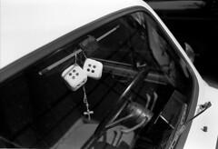 Charms (Mr. Bizi) Tags: bw 35mm beads nikon cross trix 400tx dices windshield nikkor wiper luckycharms fico fiat600 fm2n d7611 35mmf28ais ap400