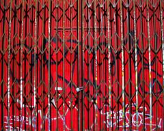 Gated Red Tagged (See El Photo) Tags: city red urban 15fav color lines writing graffiti gate pattern shadows bright tag graf tagged fav loud redness redish