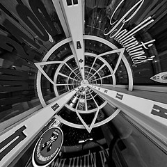 (The New Motive Power) Tags: door city windows urban blackandwhite reflection lines wheel shop facade point store focus bars distorted sofia squares spin curves front bulgaria round polar cyrillic circular radiating   canon7d