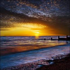 Early morning moments (adrians_art) Tags: longexposure coast shore beach seawater sky cloud sunrise waves pepples groynes whitstable kent