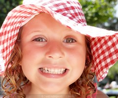 too cute! (mentalPICTURE) Tags: camera leica old girls light red portrait copyright sun white holiday david reflection beautiful smile face hat smiling by cheese kids reflections aka point fun happy eyes shoot colours bright 5 north nanny picture cyprus ps made gingham just floppy ag grin years turned cheesy sparkling x1 mental kyrenia hollingworth apsc mentalpicture girnie davidhollingworth hollingworht