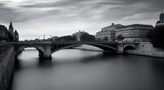 Pont dArcole. (Alastair Crompton) Tags: bridge bw white black paris france detail reflection tower water monochrome contrast docks canon buildings reflections french hotel still europe flag sigma calm notredame mooring and hotels arcitecture saintlouis stretched pompidou continent arcdetriomphe depth tress banks greyscale pontdelatournelle 600d gothinc shanzelize pontdarcoleriverseineplacedelagreveiledelaciteparis pontdarcolepontdelarcheveche