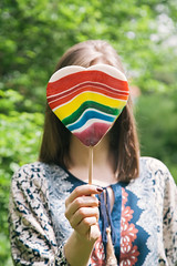 Young girl holding a huge lollipop in front of her face (PrgomeljaDusanAna) Tags: two portrait playing cute girl beautiful face childhood spiral fun happy kid big crazy holding funny pretty child dress candy little sweet expression tail small young lifestyle excited front pop her sugar lolly delicious spanish caramel pony latin huge peek swirl hispanic concept lovely cheerful lollipop lunatic lolli sugary lollypop addict isolated sucker glucose hardcandy