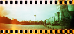 Sprocket Rocket in Cologne (somekeepsakes) Tags: film analog germany deutschland lomo xpro crossprocessed europa europe cologne kln lightleak analogue mediapark 2012 sprockets perforation lichteinfall sprocketrocket lomographyxpro200