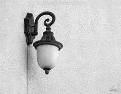Exterior Lamp (Quincey Deters) Tags: light canada building monochrome electric horizontal wall closeup concrete march exterior outdoor stucco allrightsreserved outdoorlight exteriorview lowdownangle quinceydeters