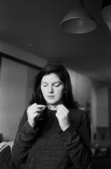 Untitled (idlike2sleep) Tags: blackandwhite white black film girl analog 35mm 50mm nikon minolta ii hp5 dimage ilford nikonfm2 fm2 floss fm2n
