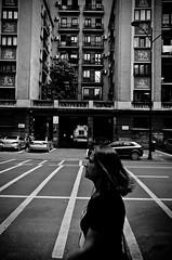 Going Somewhere (stimpsonjake) Tags: city blackandwhite bw woman monochrome lines silhouette walking apartment candid streetphotography highcontrast romania bloc bucharest 185mm nikoncoolpixa