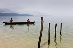 Canoe, Pendolo (Marji Lang) Tags: morning travel two mist lake holiday men boys weather fog clouds composition indonesia landscape boat fishing quiet peace escape cloudy foggy lac peaceful atmosphere calm minimal canoe zen serenity dreamy serene traveling canoeing woodenboat simple paysage sulawesi minimalist canot barque youngboys pche pcheurs evasion cano 2011 indonsie centralsulawesi cano pendolo ef2470mm lakeposo pulausulawesi canon5dmii lacposo