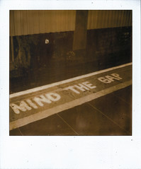 mind the gap (Ben Wolfarth) Tags: travel light bw white black station wall sepia bar train liverpool silver project underground tile polaroid sx70 photography one 1 lomo model triangle waiting looking magic flash border central dream gap tunnel filter tip shade 600 edge mind nd choo instant p analogue 70 bohemian pola folding impossible sx origional px saftey wondeful lomograghy altj px600
