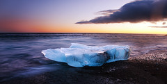 In My Cold Solitude (v on life) Tags: ocean winter sunset ice beach water colors iceland glacier jkulsrln vatnajkull blacksandbeach glaciallagoon