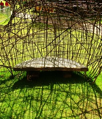 bench inside garlic (Mark and Rebecca Ford Art Sculpture) Tags: uk flowers sculpture green art love festival architecture river landscape photography countryside photo pod gallery nest westsussex surrealism wildlife screen structure tendril climbing growth galleries willow gourd installation land surrealist form woven climber carpark festivities weaving foundobject weave landart ambiguous chichester testicle wovenwillow lavant greenart chichesterfestivities apendage plantform countrycrafts wovenart housenature rebeccaford meditativespaces wovensculpture chichesterarttrail oraginicform twocirclesdesign arterialcytoplast 24thjune2012 riverhopeproject