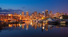 Vancouver (Thierry Hennet) Tags: city longexposure bridge light canada reflection building architecture night vancouver zeiss harbor boat cityscape waterfront harbour britishcolumbia sony highrise citylight traveldestinations a900 cz2470mmf28