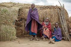 Masai Village (flamed) Tags: poverty africa travel portrait feet tanzania village native sandals country straw safari barefeet masai basic primitive eastafrica informal masaivillage 3rdworld ndutu tribeswoman strawhuts workingtheearth