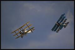 Sopwith and Fokker Triplanes (littlemissspidey) Tags: digital photography nikon military d70s surrey airshow planes dslr runway redarrows aeroplanes airfield dunsfold wingsandwheels wingsandwheels2012