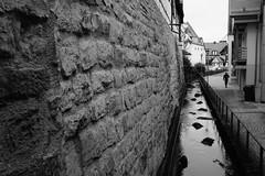 Wall (stefankamert) Tags: fujifilm fuji street wall bw sw baw noir noiretblanc x100 x100s blackandwhite blackwhite schwarzweis city town man alienskin exposure