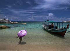 Moments of sunshine (Robyn Hooz) Tags: sky sun beach sunshine clouds umbrella indonesia boat barca cielo moment spiaggia ombrello belitung