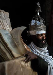 Ethiopian orthodox priest with an old bible in nakuto lab rock church, Amhara region, Lalibela, Ethiopia (Eric Lafforgue) Tags: africa people man color church vertical silver religious reading book clothing day adult african faith religion monk christian unescoworldheritagesite holy indoors monastery devotion bible civilization crown priest christianity shawl spirituality ethiopia oneperson developingcountry gez lalibela engravings hornofafrica geez ethiopian eastafrica orthodoxchurch abyssinia manuscripts traditionalclothing realpeople cavechurch waistup adultonly onematuremanonly traveldestination 1people africanculture amhararegion ethio161347