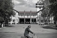 Firefighters (Alexei L) Tags: street city people black monochrome bike fire town blackwhite ukraine 101 firefighters bycicle shostka