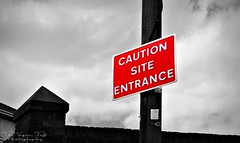 Caution (The Vegan Taff Photography) Tags: uk red urban blackandwhite sign closeup southwales wales warning outside outdoors outdoor text cymru samsung caution roadsign signpost lettering colorsplash coloursplash blackandwhitephotography phonephotography colourpop colorpop note4 galaxynote galaxynote4