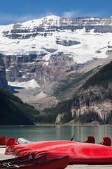 Summer on the Lake (Serthra) Tags: canoneos5dmarkii canon5dmark2 rockies rockymountains lakelouise lake red mountains canoes summer snow