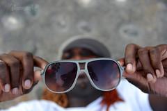 Fooling Around (Heidi Zech Photography) Tags: portrait musician man sunglasses dreadlocks jamaica jamaican jamaicanman photosbyheidizech coloreddreadlocks coloureddreadlocks