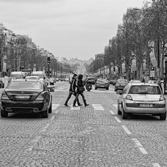 Clowns to the left of me, jokers to the right. (martinfowlie) Tags: road street trees people paris france cars lines champselysees boulevard traffic cobbles stuckinthemiddlewithyou stealerswheels scrapingthebarrelnowintermsofparispics