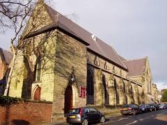 Dappled Church in Stone, 3 Jan 2009 (DizDiz) Tags: uk england stone staffordshire buttresses canaltown olympusc720uz january2009