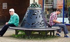SittingRound (Hodd1350) Tags: reflection men window back weeds sitting pavement seat olympus hampshire males acorns checks ringwood penf zuikolens