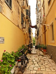 Street in Kerkira (Flimflim) Tags: street old houses greek alley pastel greece laundry mopeds blinds venetian clothesline moped corfu griekenland kerkira corfutown