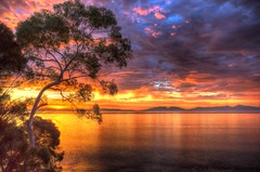 Sunrise on the Great Oyster Bay (myshutterworld) Tags: sunset panorama moon beach sunshine swansea clouds sunrise landscape nightscape pano under australia down moonlit moonrise tasmania tassie hdr chalets freycinet