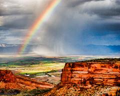 1377 Storm and Rainbow- Artistic (paule48) Tags: usa weather landscape rainbow colorado desert artistic badlands habitat stormcloud escarpment coloradonationalmonument