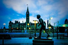 Dusk falls on Terry Fox and the Peace Tower (beyondhue) Tags: light sculpture ontario canada tower art monument public lamp evening peace dusk flag ottawa low hill parliament canadian fox terry beyondhue