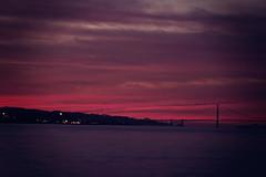Golden Glow (Leighton Wallis) Tags: sanfrancisco california birthday ca sunset orange usa clouds island treasure dusk unitedstatesofamerica goldengatebridge sihouette 75thanniversary ggnpc11